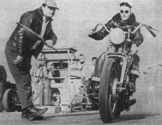 Woman Racing Motorcycle