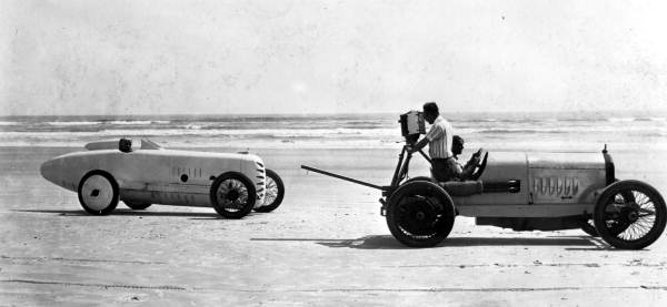 Sig Haugdahl in the Wisconsin Special being filmed on the beach in 1922