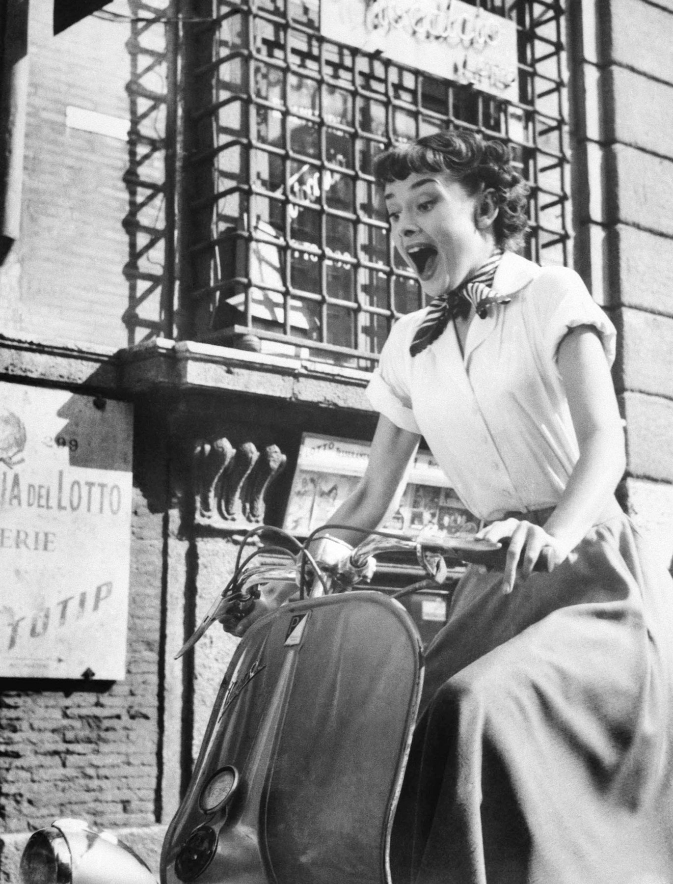 Audrey Hepburn and her Vespa