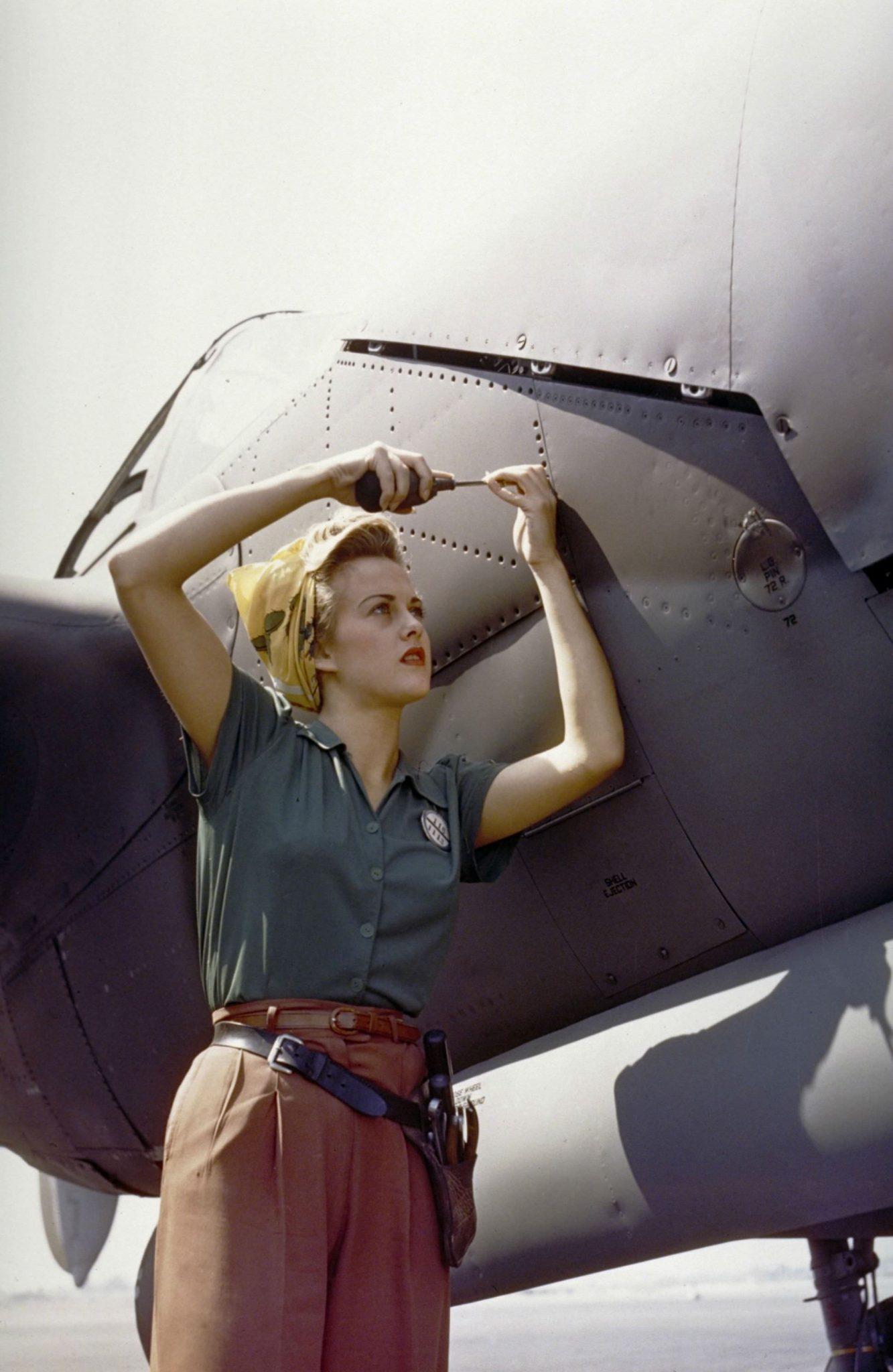 Female Lockheed employee working on a P-38 Lightning, Burbank, California, 1944