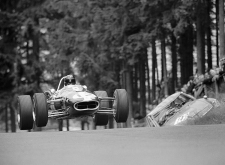 Dan Gurney gets air at the Nurburgring note the crashed salloon in the background from a previous race 450x330 - Dan Gurney