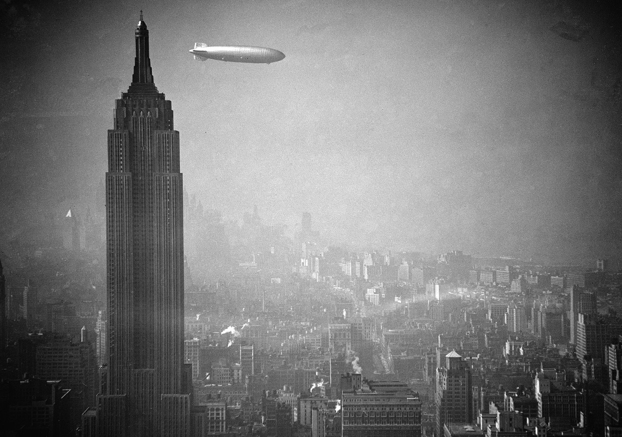 The Hindenburg floating past the Empire State Building in 1936
