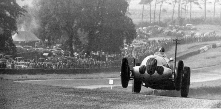 Manfred von Brauchitsch is airborne in his Mercedes Benz at Melbourne Rise. Donington Grand Prix.