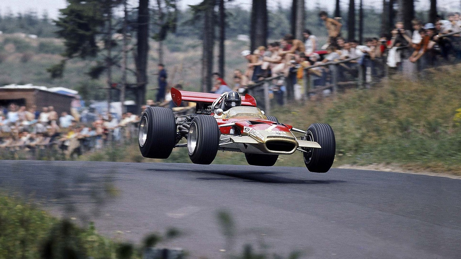 Graham Hill driving the Lotus 49 in 1969 1600x900 - Desktop Wallpaper: Graham Hill Flying The Lotus 49