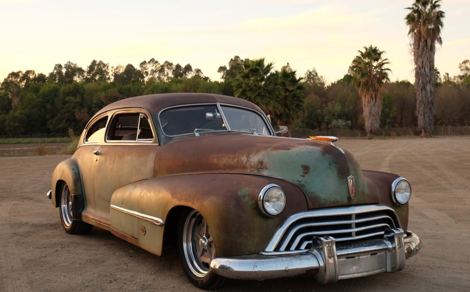 ICON Derelict Oldsmobile F34 Sunset Hero 1600x993 - 1946 Oldsmobile ICON Derelict Coupe