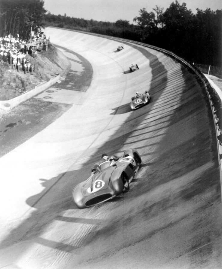 Juan Manuel Fangio leads Stirling Moss, Piero Taruffi, and Karl Kling on the Monza banking at the 1955 Italian Grand Prix