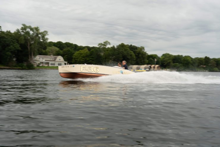 Bugbite Mahogany Speedboat On Water 1