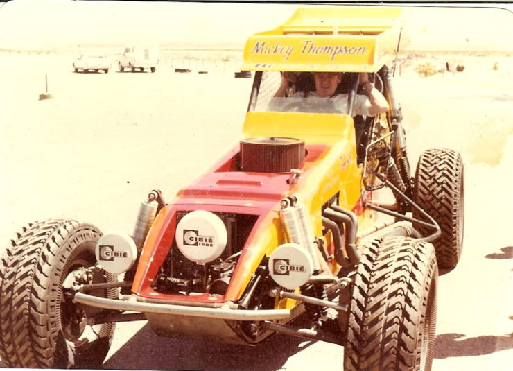 Mickey Thompson strapping himself in Challenger IV during testing prior to the 1978 MINT 400 after adding 8 wheel base to the car after crash. Photo credit Bruce Parrish