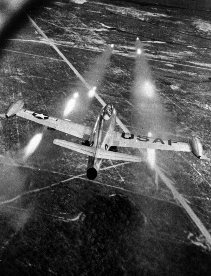 An F-84E attacks a ground target with rockets - National Museum of the U.S. Air Force