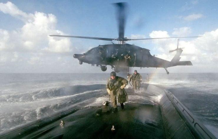 U.S. Army MH-60L Blackhawk from the 160th SOAR deploys an ODA from 7th SFG(A) onboard a U.S. submarine