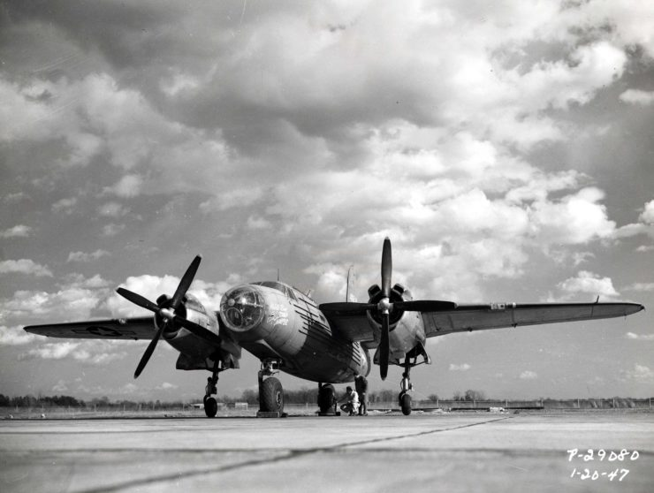 A low-angle view of the XB-26H Marauder and its experimental bicycle landing gear.